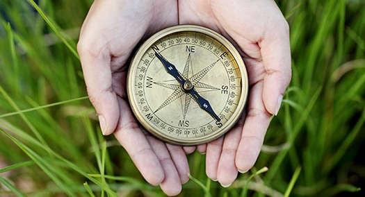 Hands Holding A Old Compass