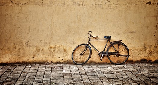 Old Vintage Bicycle Near The Wall